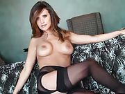 Cute brunette Carlie Christine dressed in sexy black lingerie and stockings