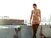 Naked hottie in stocking on the roof top
