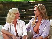 Two hot chicks exposing their perfect tits while having conversation