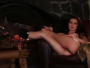 Naked babe by the fireplace