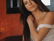 Pretty brunette gets naked for you