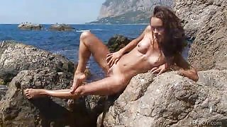 Hot girl exposes her body on the rocks