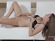 Astonishing Josephine masturbates on the white couch