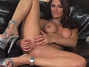Fantastic brunette with big boobs plays with her wet pussy