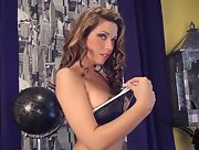 Busty brunette babe Vicky Burns in solo action