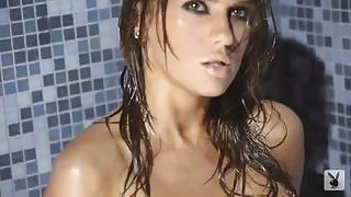 Wet and playful Sydney Barlette poses eroticaly for the fans