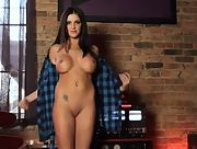 Curvy and busty brunette Chrissa Carolyn takes her clothes off slowly
