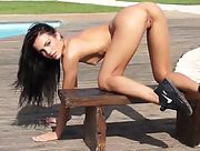 Incredible perky babe Sapphira spreads her legs wide open to reveal a juicy pink pussy