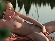 Charming horny brunette Sophie Lynx works her muff outdoors