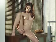 Perky brunette Minnie Manga strips and plays with her delicious wet pussy