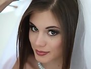 Smoking hot brunette bride Little Caprice strips and poses in a wedding dress