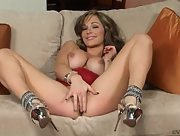 Spectacular busty brunette Destiny Dixon strips and works her pussy on the sofa