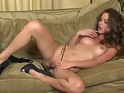 Charming curvy brunette Malena Morgan in solo action on the sofa