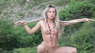 All natural blonde Whitney C exposes her assets outdoors