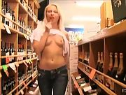 Tempting blonde babe Krystal strips and teases in the store