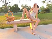 Magnificent babe Madi works her pussy and strips outdoors