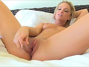 Foxy and horny blonde Sydney plays with a big toy on the bed