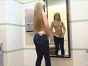Sexy blonde Sydney shows off her sexy curves in a public bathroom
