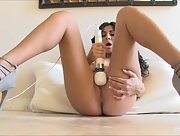 Foxy beauty Ariane toys her pussy with her high heels on
