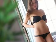 Curvy brunette Valeria slowly steps in the nude