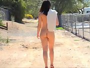 Slender young babe Kylie strips to her skin outdoors