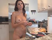 Ravishing busty milf Eva makes breakfast with no clothes on
