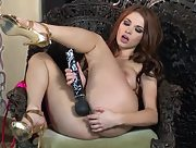 Irresistible Sabrina Maree plays with toys in the armchair
