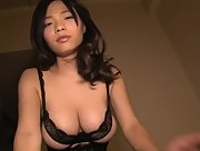 Curvy and busty Takahane Mio teases erotically in hot black lingerie