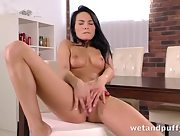 Dark haired Lexie strip teases erotically as she slides her fingers in her sweet pussy before getting her both holes filled