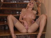 Hottie in tight stockings Randy Moore is horny on the stairs