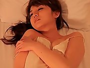 Hot busty babe Nana Ozaki gets naked in her bed