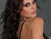 Ravishing busty bombshell Shelly Lee undresses and teases by the fireplace