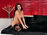 Tattooed busty beauty Shelly Lee teases erotically in sexy black lingerie