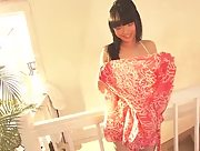 Tomoe Yamanaka undresses and poses in high heels