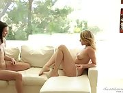 Young lesbian lovers Georgia Jones and Mia Malkova undress each other on the couch