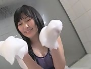 Natsu Aiuchi takes a bubble bath in a tight swimming suit