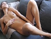 Lovely petite babe Leonie is having fun in the kitchen and calling you to taste her