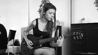 Babe with nices round breasts Mila shows you her guitar playing skills