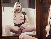 Devilish blonde girl Lucy Heart moans with a mouth gag as she rubs her pussy hard