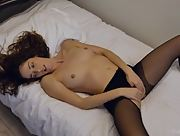 Young horny chick with a seductive body strokes her wet vag