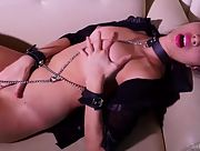 Magnificent Arissa displays her puffy tits and hot pussy as she plays with chains and leather