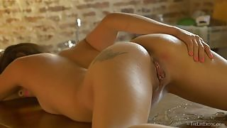 Irresistible tanned babe masturbates on the bar and plays with blocks of ice