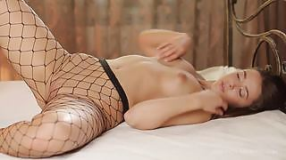 Sybil A dazzles us with her sexy fishnets as she gets horny and naughty in her bedroom