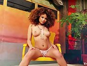 Absolutely cute ebony babe Cecilia Lion playfully poses naked and teases with her hot curves