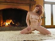 Redhead bombshell Molly Stewart strips naked and showcases her fantastic naked body