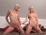Incredibly hot blondes pose in a hot lesbian embrace in front of camera and play with two sided toy