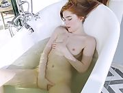 Sensual redhead girl Jia Lissa teases her delicious pussy as she lays in hot bath