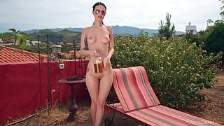 Dita V pours oil on her sexy body and poses on the sunbed