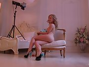 Sit back and watch sexy blonde Teresa posing in front of her photographer