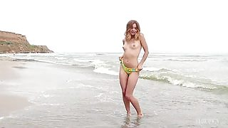 Kaleesy simply adores to go on her favorite beach and get wet without her bikini